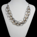 Silver Tone, Gold Tone & Gun Metal Triple Strand Necklace