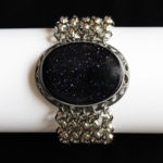 Blue Gold Stone Focal on Five Strand Silver Tone Rollo Bracelet